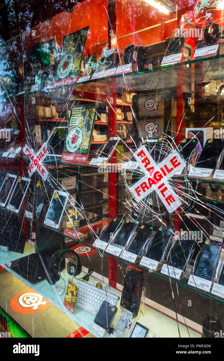 Attempted Smash and Grab break in at a CEX store in Cambridge UK - Stock Image