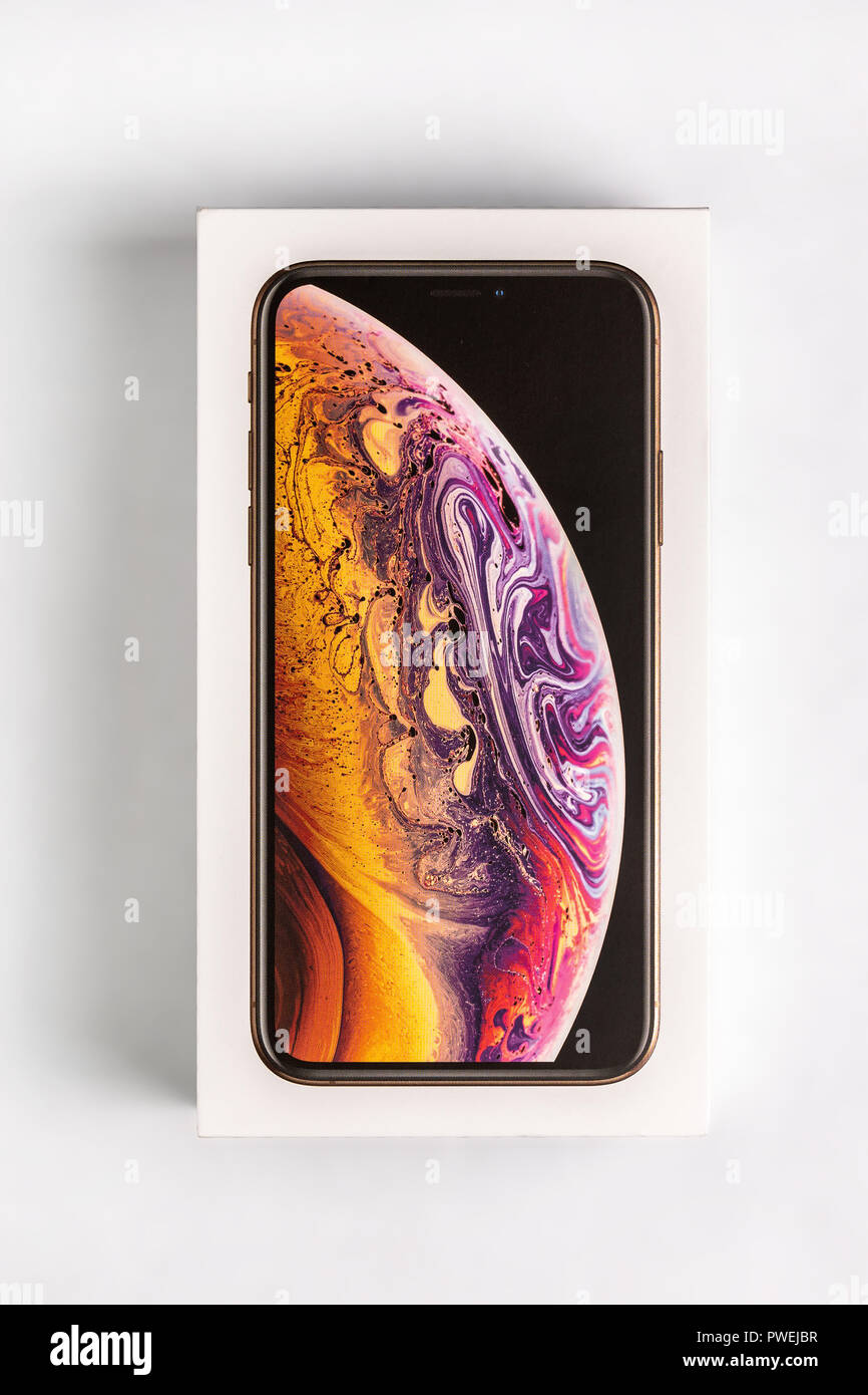 12th October,2018-Kiev,Ukraine: Latest Iphone XS in unopened box on white table. Newest Apple smartphone on white branded box in mobile store. Modern gadget with dual camera and OLED screen for sale - Stock Image