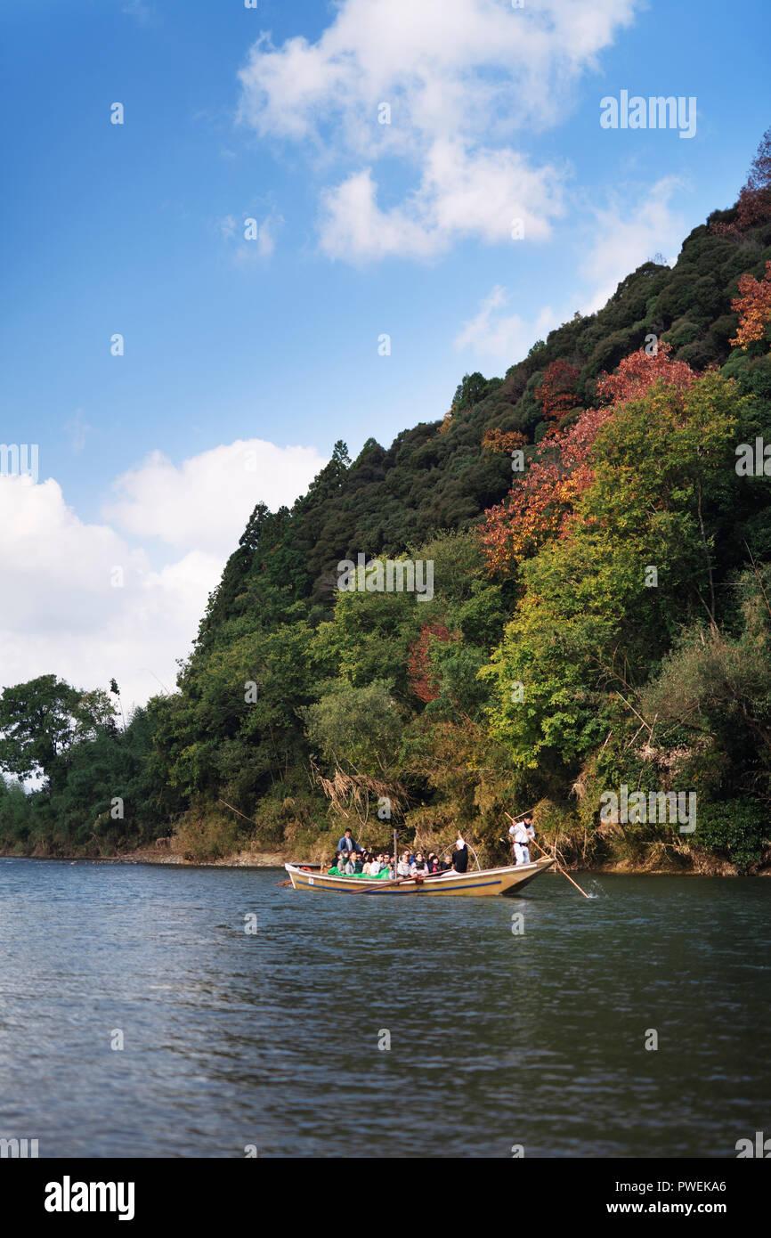 People enjoying a sightseeing ride on Hozugawa river boat cruise, Hozugawa Kudari, from Kameoka to Arashiyama, Kyoto, Japan 2017 - Stock Image