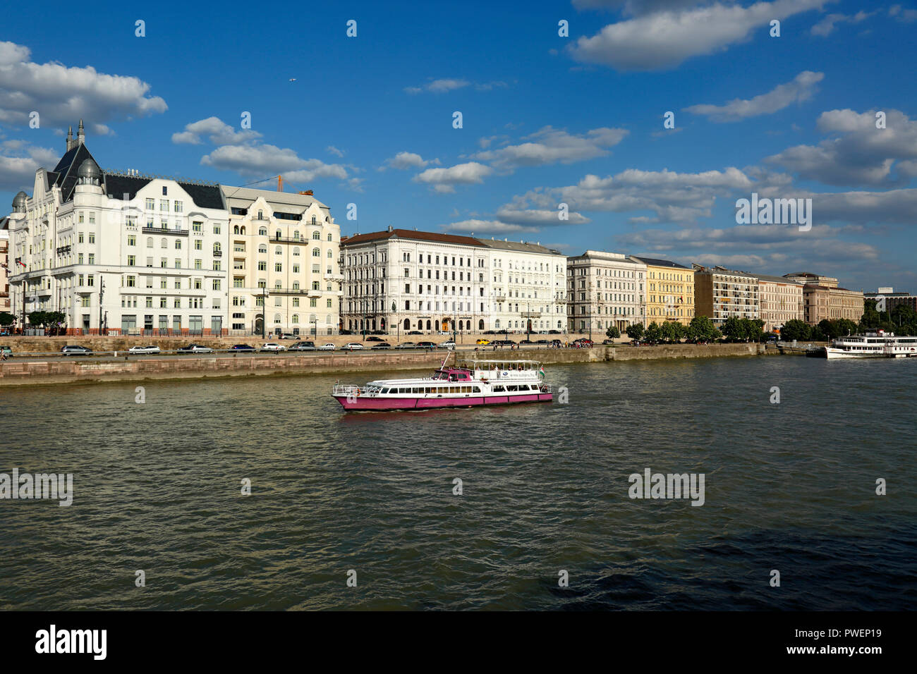 Hungary, Central Hungary, Budapest, Danube, Capital City, Danube bank of Pest, Danube landscape, business houses and residential buildings, excursion ship on the Danube, river navigation, UNESCO World Heritage Site Stock Photo