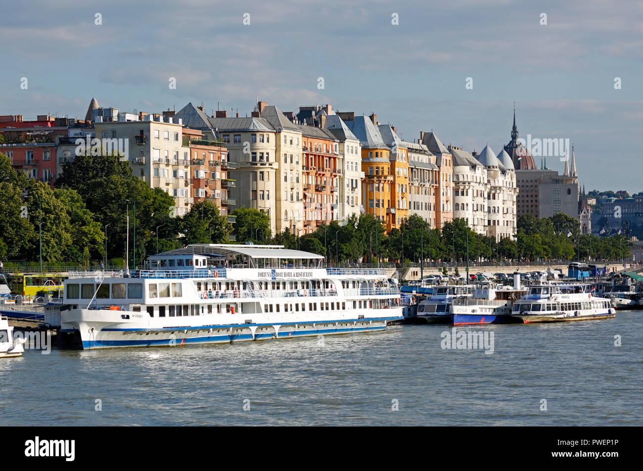 Hungary, Central Hungary, Budapest, Danube, Capital City, Danube bank of Pest, Danube landscape, business houses and residential buildings, shipping pier, ships, river navigation, UNESCO World Heritage Site Stock Photo