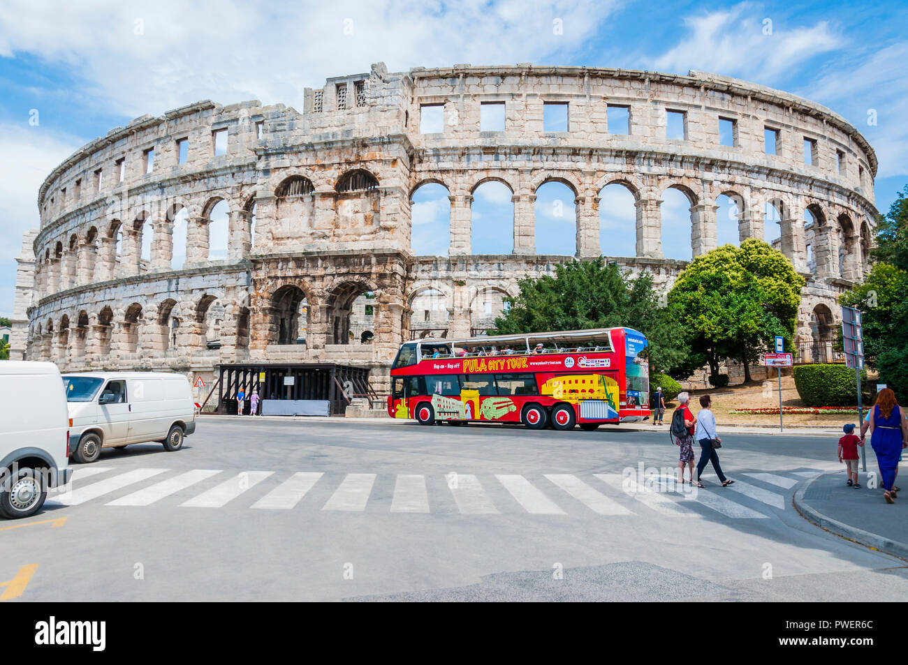 Pula, Croatia - June 18, 2014: Amphitheater or Pula Arena. Local city people and tourists passing the streets near the Arena. The most famous and impo - Stock Image