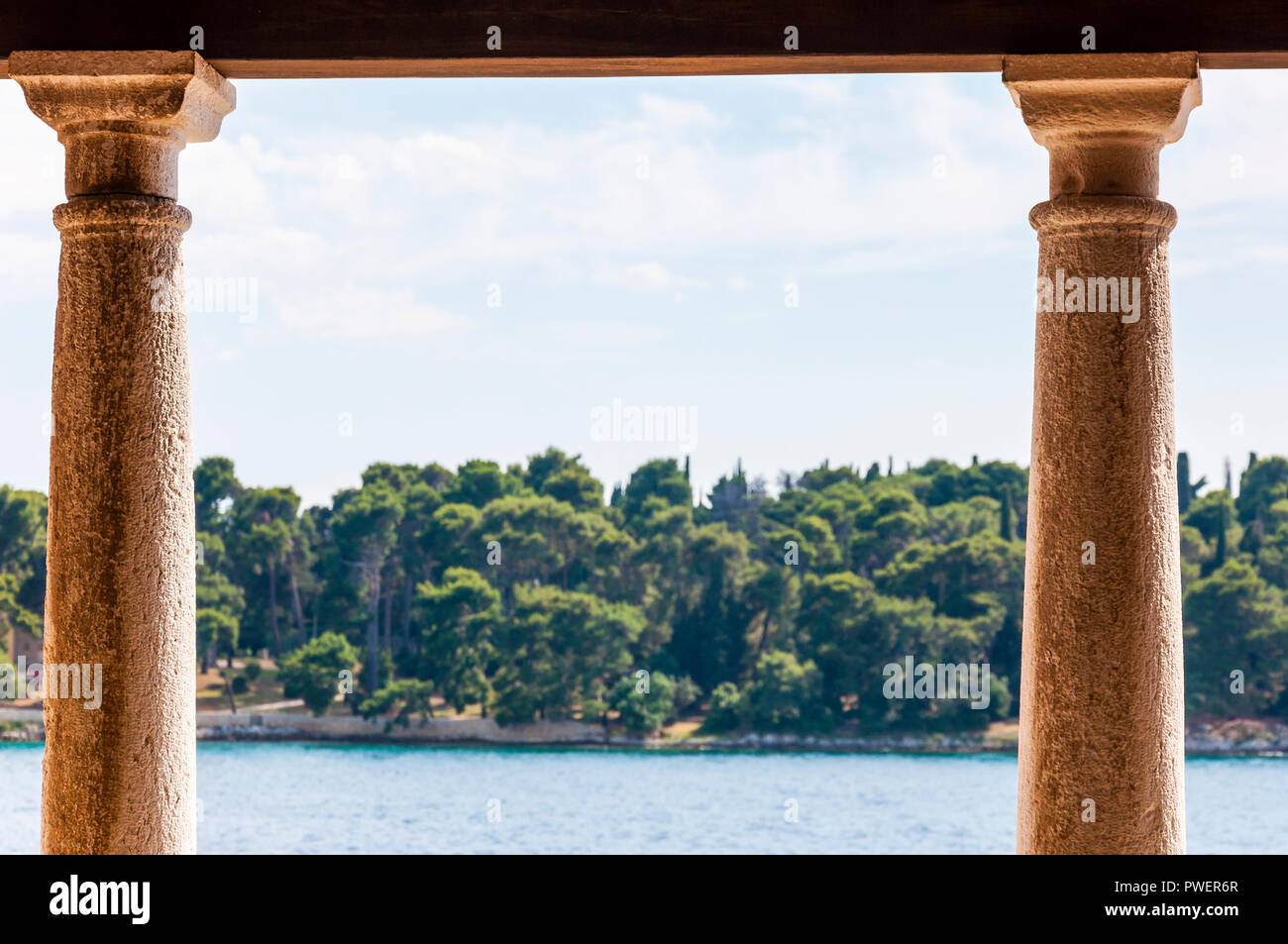 Northern Croatia. View from one of the medieval streets open air galleries in Old Town of Rovinj. On a foreground you can see the medieval architectur - Stock Image