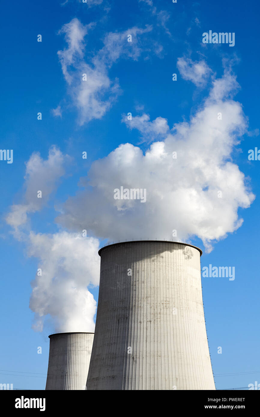 Smoking chimneys against the blue sky, environmental pollution concept. Stock Photo