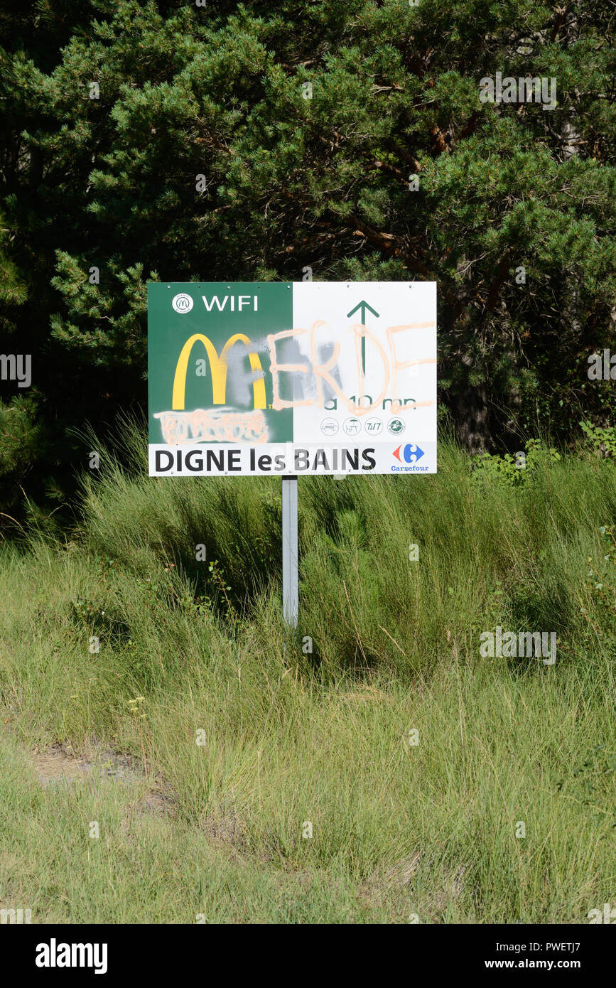 Defaced or Vandalised McDonalds Sign near Dignes-les-Bains France - Stock Image