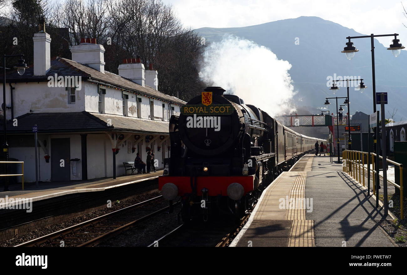 The Royal Scot Train passing through Penmaenmawr Train Station on the 14th of April 2018. - Stock Image
