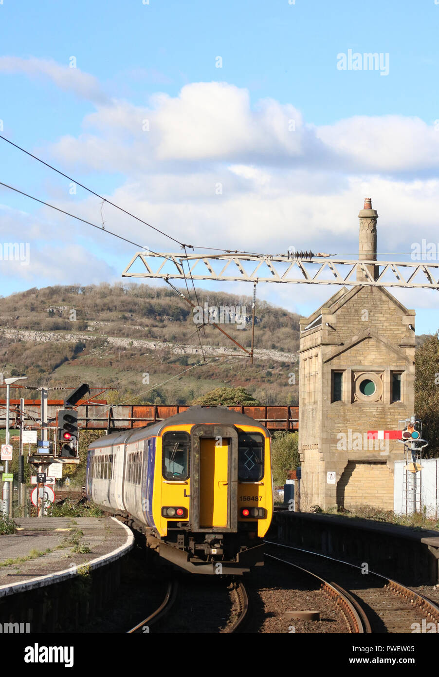 Class 156 Super Sprinter dmu in Northern livery leaving platform 2 at Carnforth station with a passenger service to Sellafield on 15th October 2018. - Stock Image