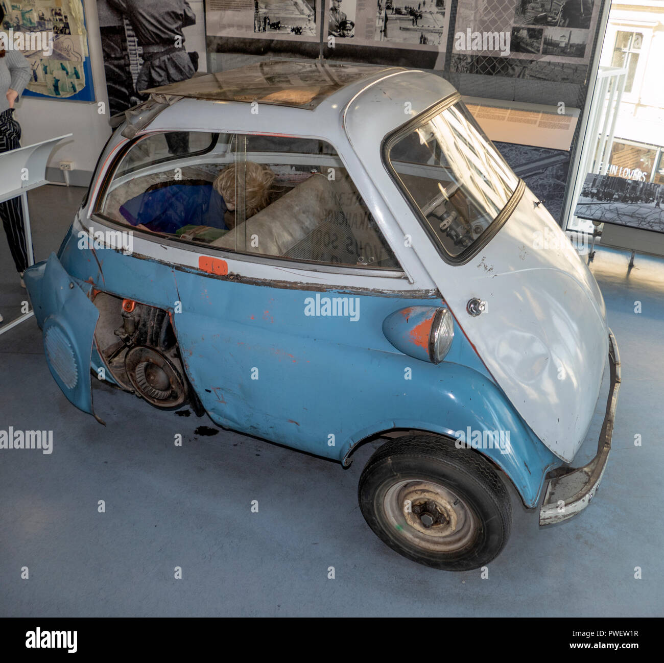 This BMW Isetta was used to smuggle nine people across the Berlin Wall, from the East to the West side. - Stock Image
