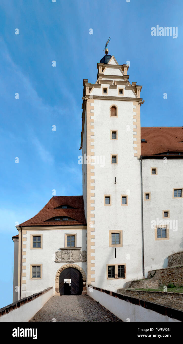 The clock tower over the moat bridge. Castle Colditz or Schloss Colditz in Colditz, Germany. A Renaissance castle most famously known as Oflag IV-C. - Stock Image