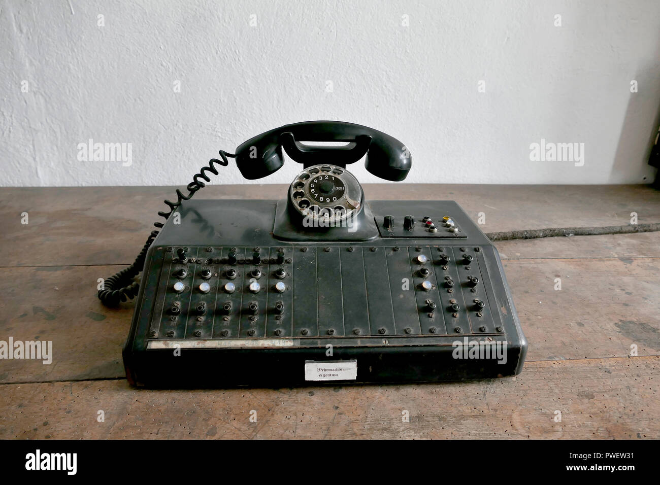 A telephone switchboard with notice 'Wehrmachts eigentum' in the entrance guard room. Castle Colditz or Schloss Colditz in Colditz, Germany. - Stock Image