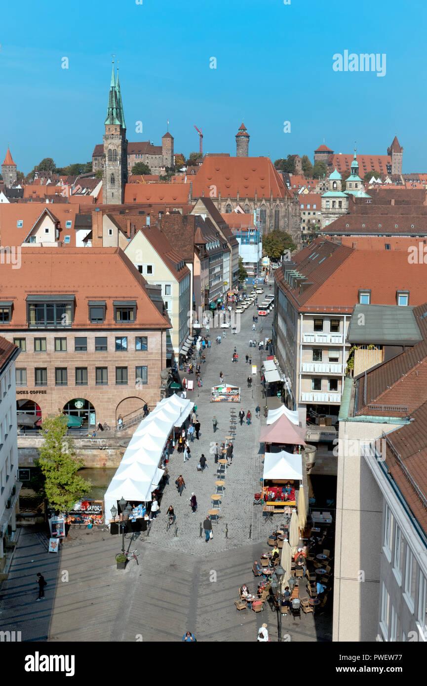 The spire of St. Sebaldus Church far left on the Historical Mile in Nuremberg, Germany Deutschland 2018 - Stock Image