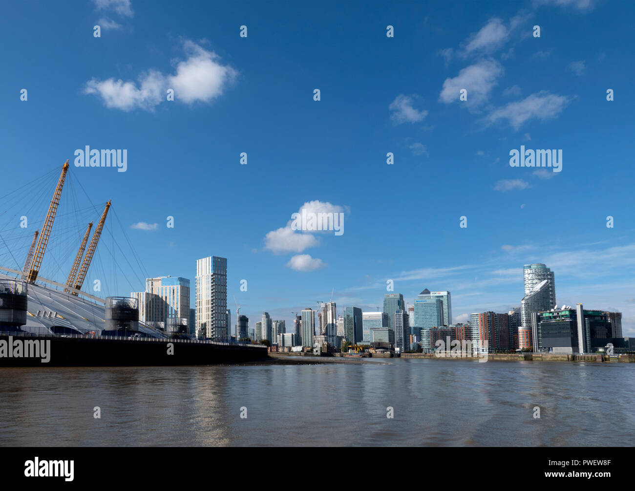 London O2 Arena / Millennium Dome at Greenwich Docklands and the skyline of Canary Wharf. - Stock Image