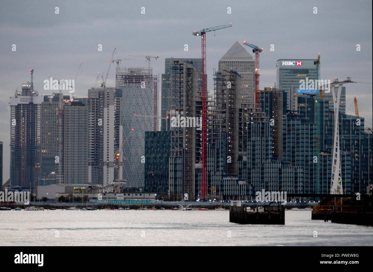 New Thames riverside skyscrapers rise up near Canary Wharf Docklands, London, England. - Stock Image