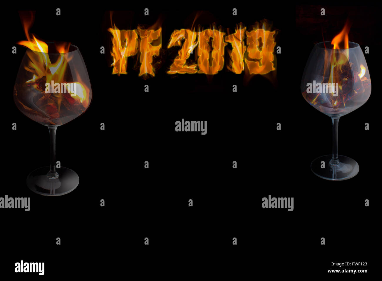 PF 2019 - happy New Year with two glasses in a fire on black ...