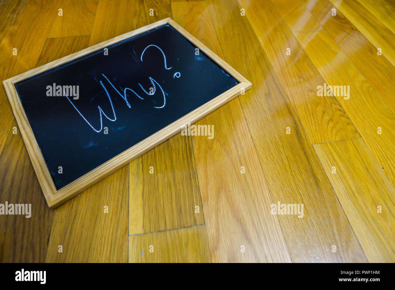 Why written on a chalk board - Stock Image