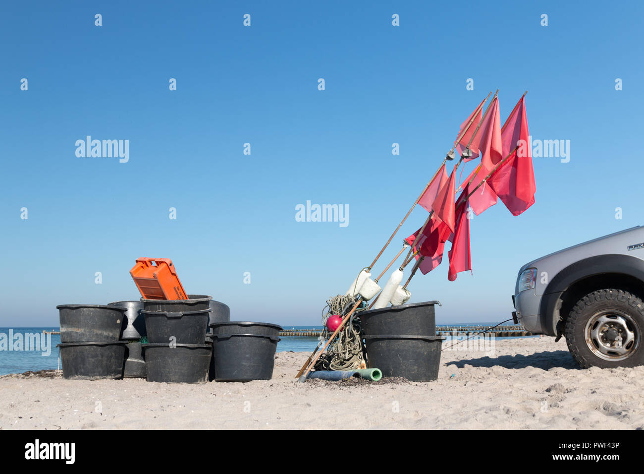 Equipment of a fisherman on the beach of the Baltic Sea. - Stock Image