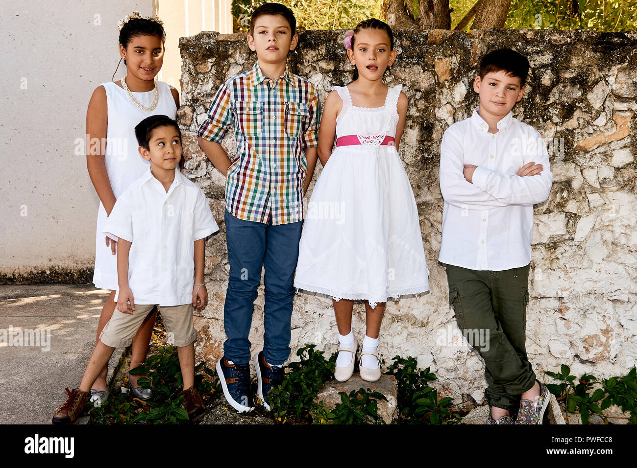 MERIDA, YUC/MEXICO - NOV 18, 2017: Portrait of mexican children (siblings and cousins) outside church, after attending the baptism of baby cousins - Stock Image