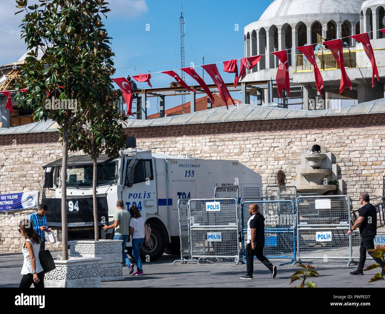 Istanbul, Turkey, September 2018: Armoured white water cannon of the Turkish police and police barriers at Taksim Square - Stock Image