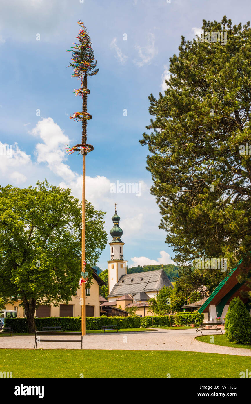 Traditional decorated maypole in alpine village St.Gilgen, Austria.Maypole is erected during folk festival on May 1 - Stock Image