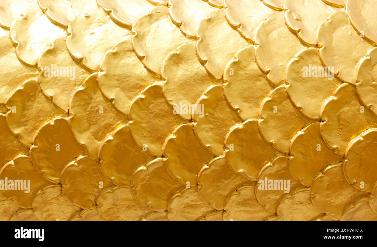 Scaly dragon stucco wall Textured pattern background - Stock Image