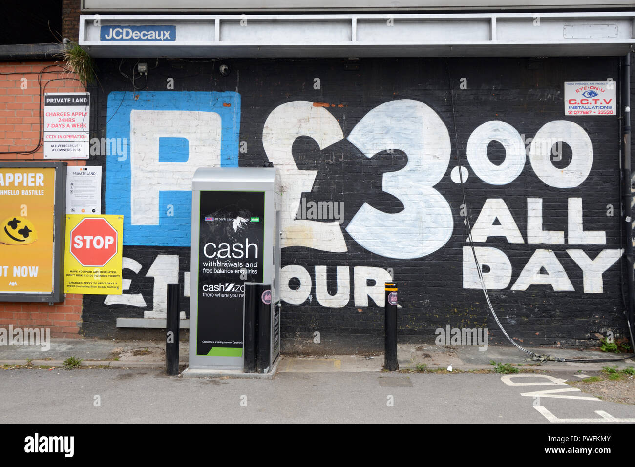 Car Park with Parking Rates and Pay and Display Machine at Digbeth Birmingham England - Stock Image