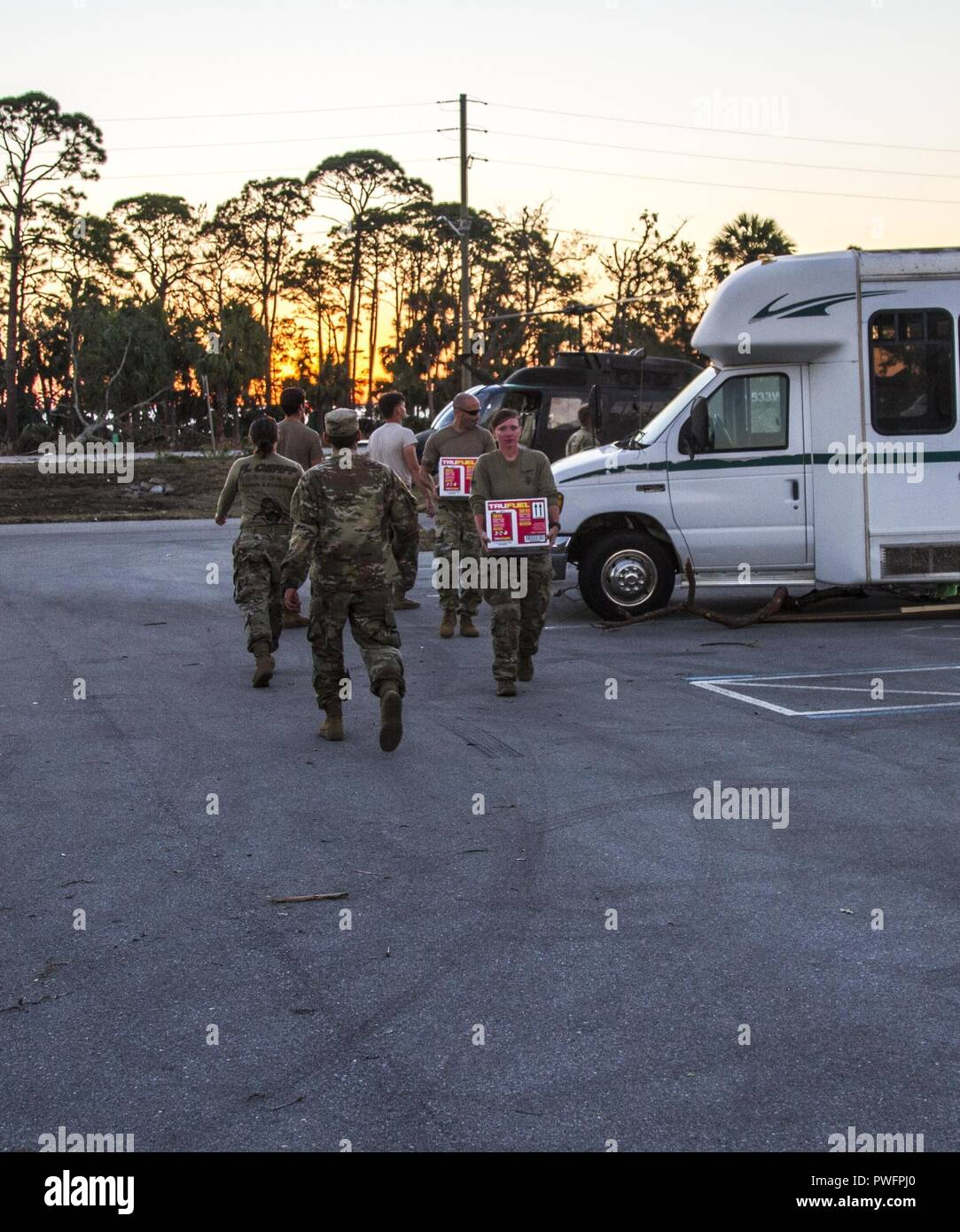 Members of the Florida National Guard's CERF-P (Chemical, Biological, Radiological, Nuclear and high-yield Explosive (CBRNE) Enhanced Response Force Package) unit offload supplies that need to be replenished as they continue their hurricane relief efforts in Florida's panhandle, Oct. 13, 2018, October 13, 2018. Hurricane Michael decimated the panhandle as it made landfall, which left hundreds of thousands people without power, food or water. () - Stock Image