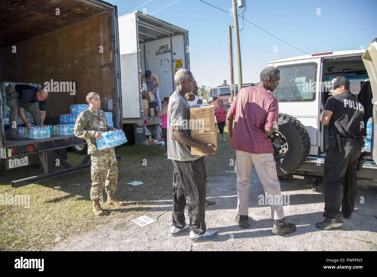 Blountstown, FL, October 13, 2018 - volunteers load vehicles with food and water at a Point of Distribution site during Hurricane Michael relief efforts, October 13, 2018. Point of Distribution or POD is where the public goes to pick up emergency supplies following a disaster. Spc. Andrea Serhan/CAISE. () - Stock Image