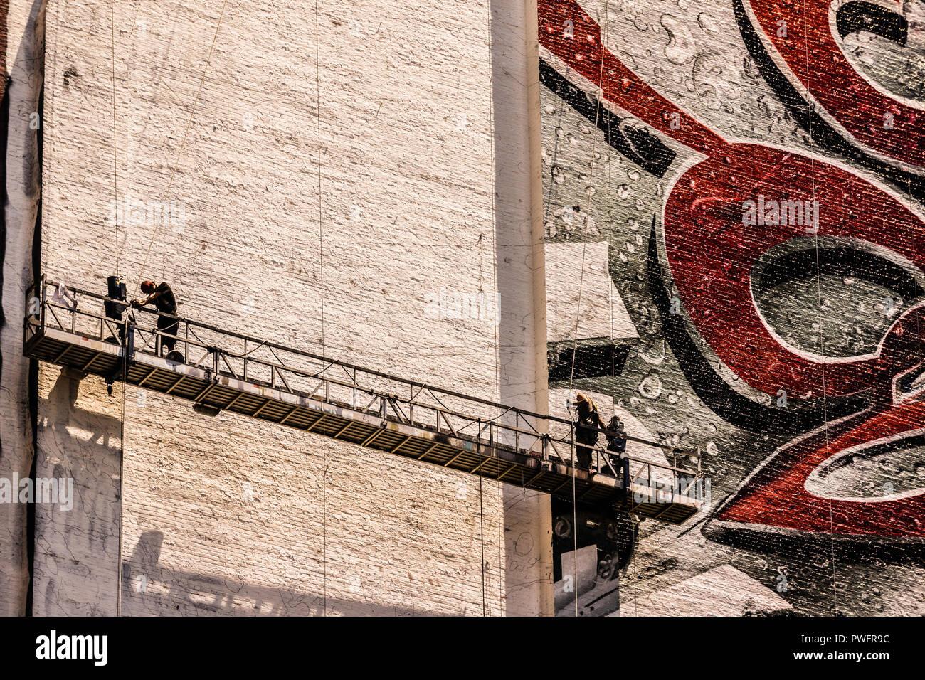 Billboard Painters Northeast corner of 34th. Street and 8th. Avenue Manhattan _ New York, New York, USA - Stock Image