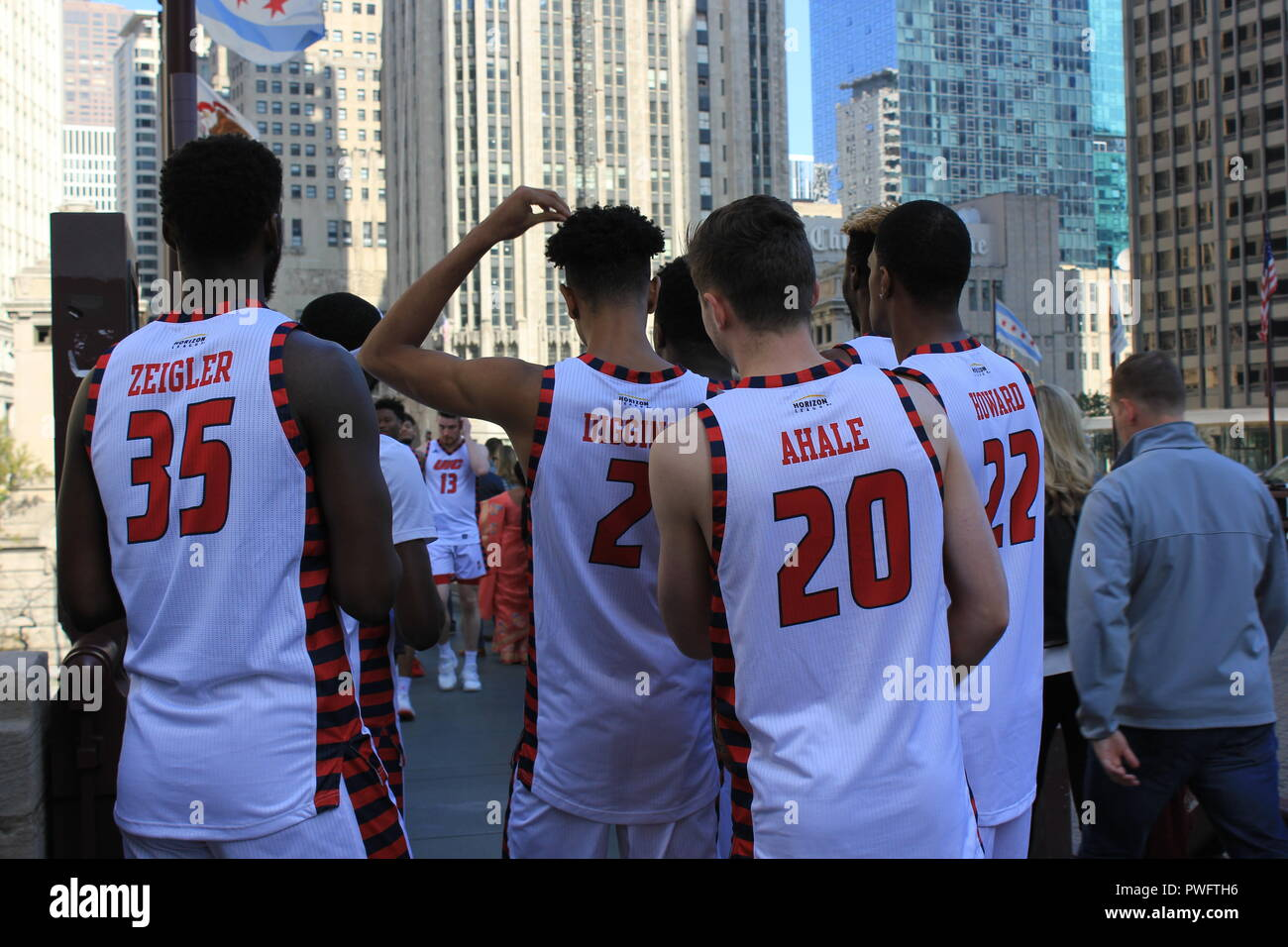#rawimagery raw imagery and candid photography College basketball team player scratching his head on Michigan Avenue. Diggins, Ahale, Ziegler - Stock Image
