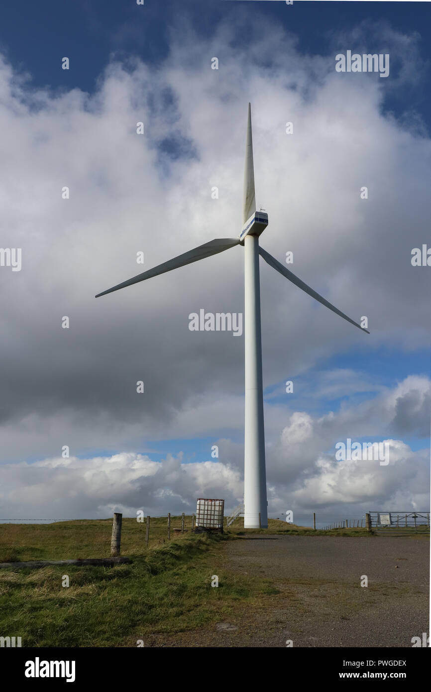 Huge 3 blade horizontal-axis wind turbine at Northfield, Burray, Orkney, Scotland against a cloud filled blue sky.  Wind power generator of electrcity - Stock Image