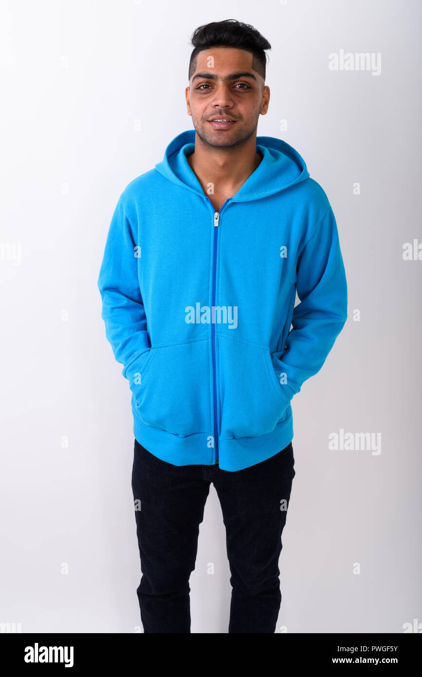 76c5f473 Young Indian man wearing hoodie against white background Stock Photo ...