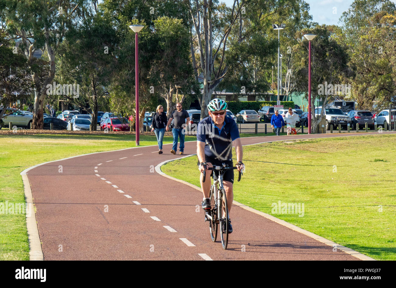 Cyclist riding bike bicycle cycling on a cycleway path in Burswood Perth Western Australia - Stock Image