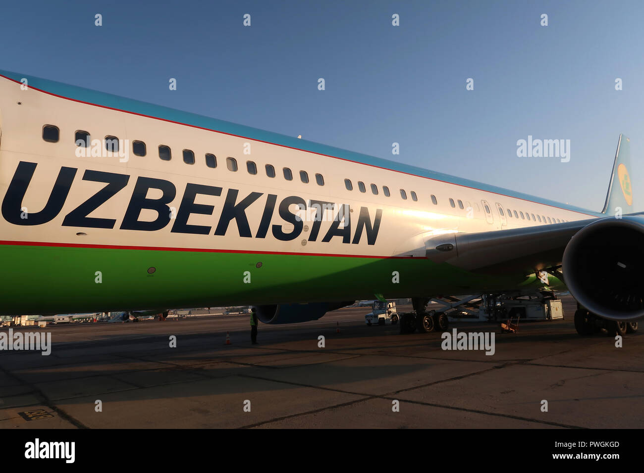 An airplane of National Air Company Uzbekistan Airways stand on the tarmac at Tashkent International Airport Uzbekistan - Stock Image
