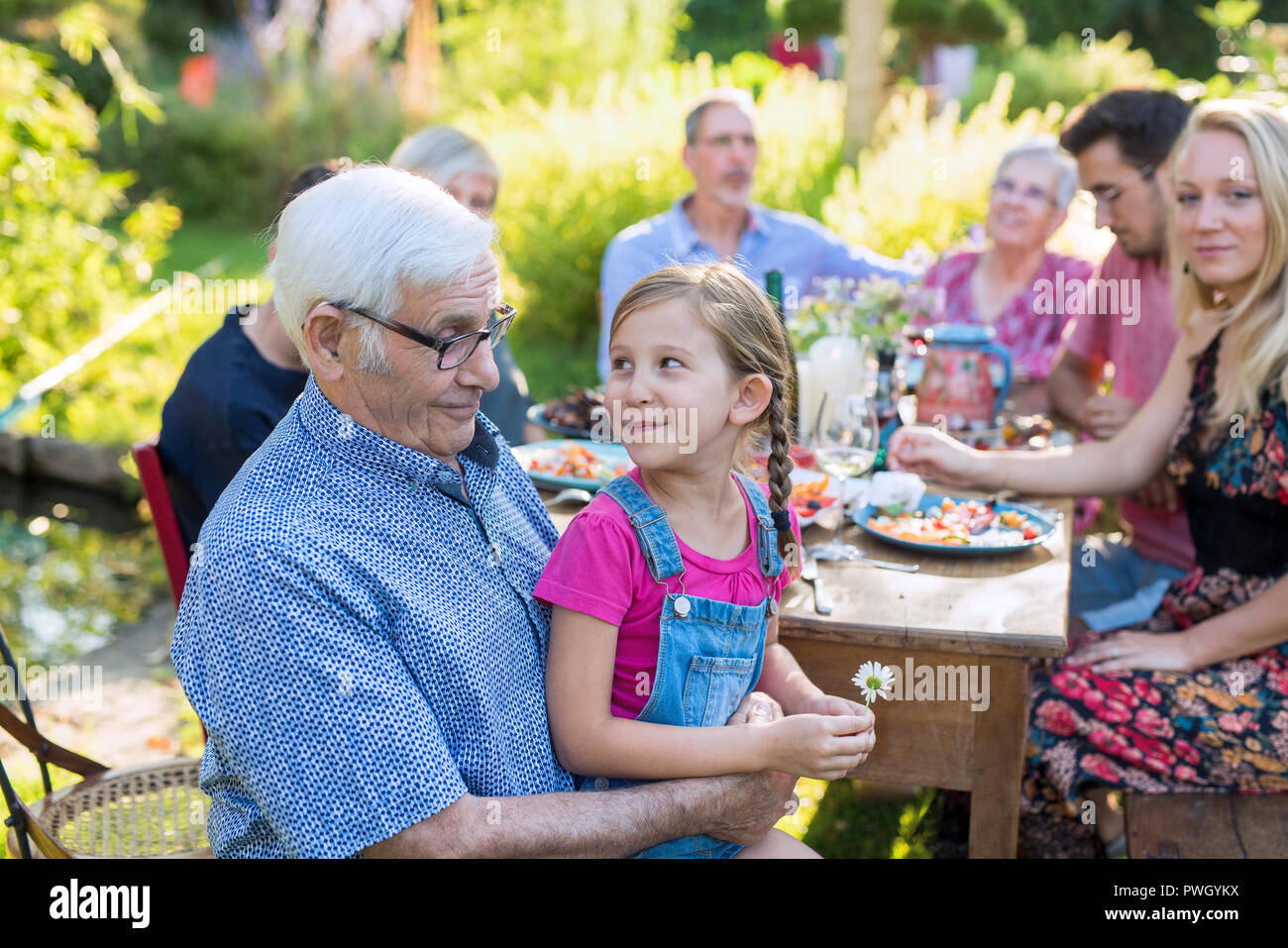 Family picnic closeup on a grandfather and his granddaughter - Stock Image