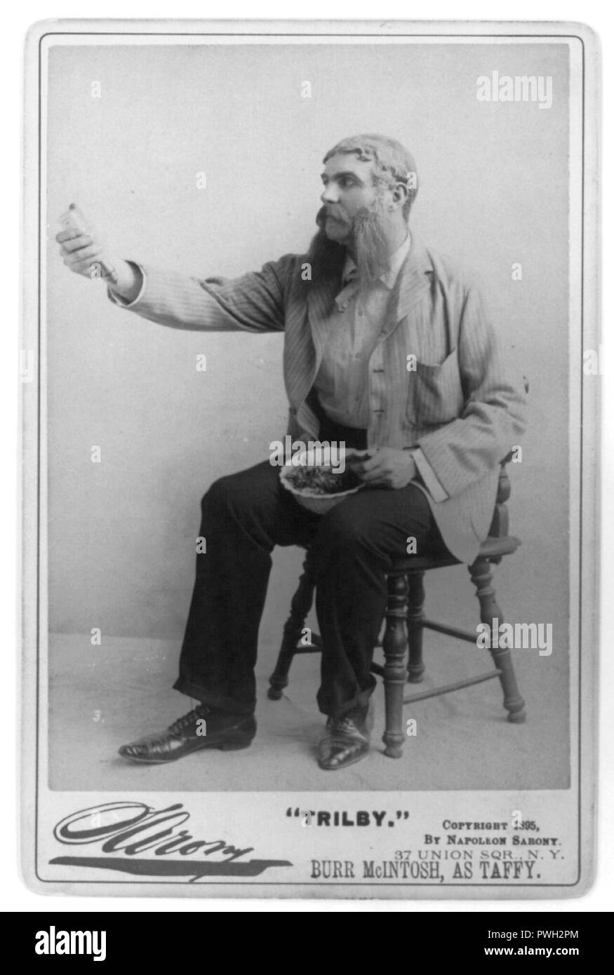 Burr McIntosh, 1862-1942, full length, seated, facing left; as Taffy in 'Trilby' Stock Photo