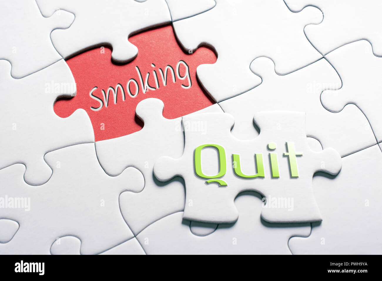 The Words Quit And Smoking In Missing Piece Jigsaw Puzzle - Stock Image