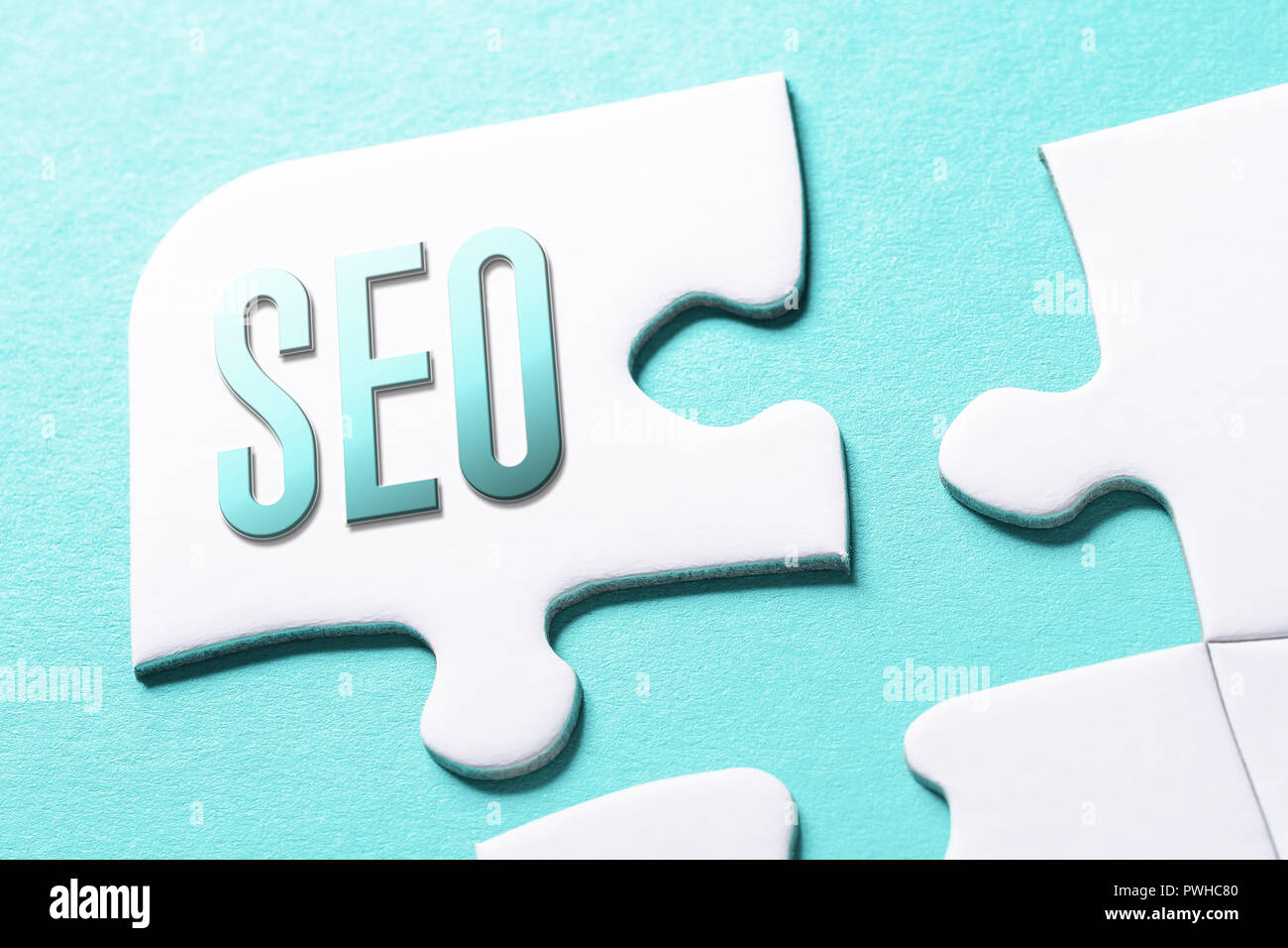 The Word SEO In Missing Piece Jigsaw Puzzle - Stock Image