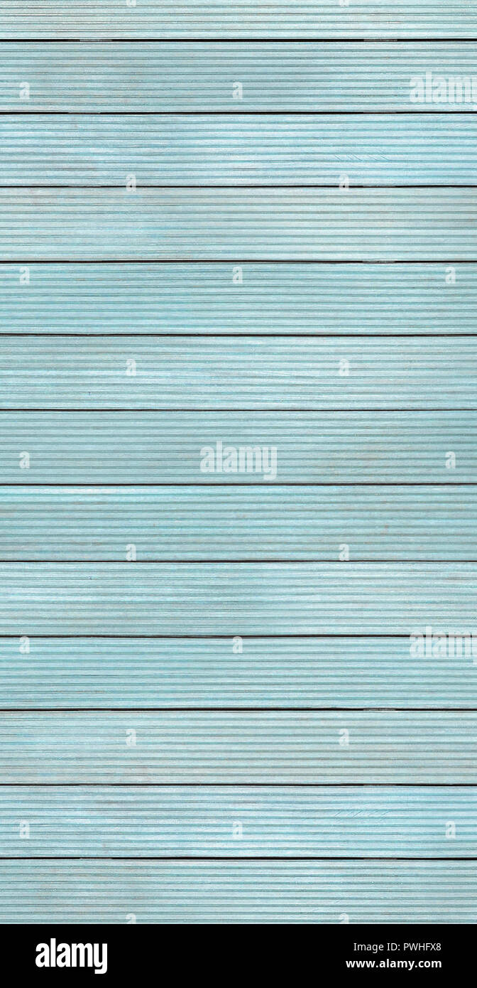 Vertical image of pale blue decking boards - Stock Image