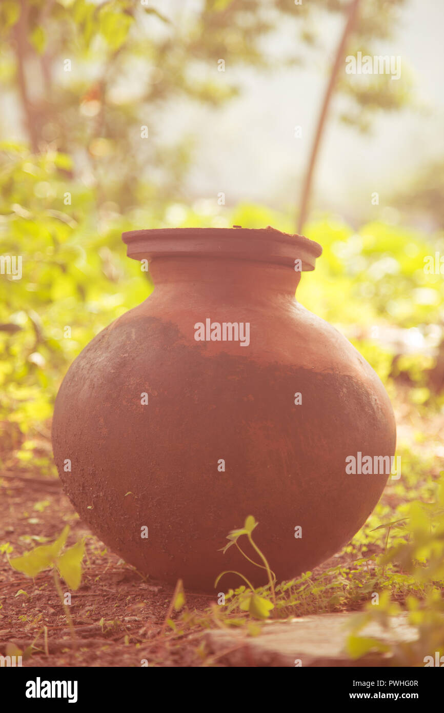 Drinking Water Stored In a Clay Pot - Stock Image