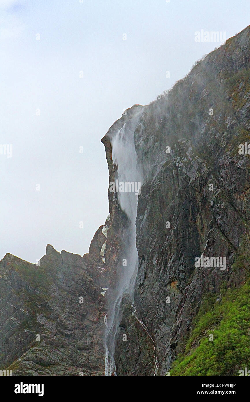 Water falls in Western Brook Pond, Gros Morne National Park, Newfoundland, Canada, Tabletop Mountains, inland fjiord Stock Photo
