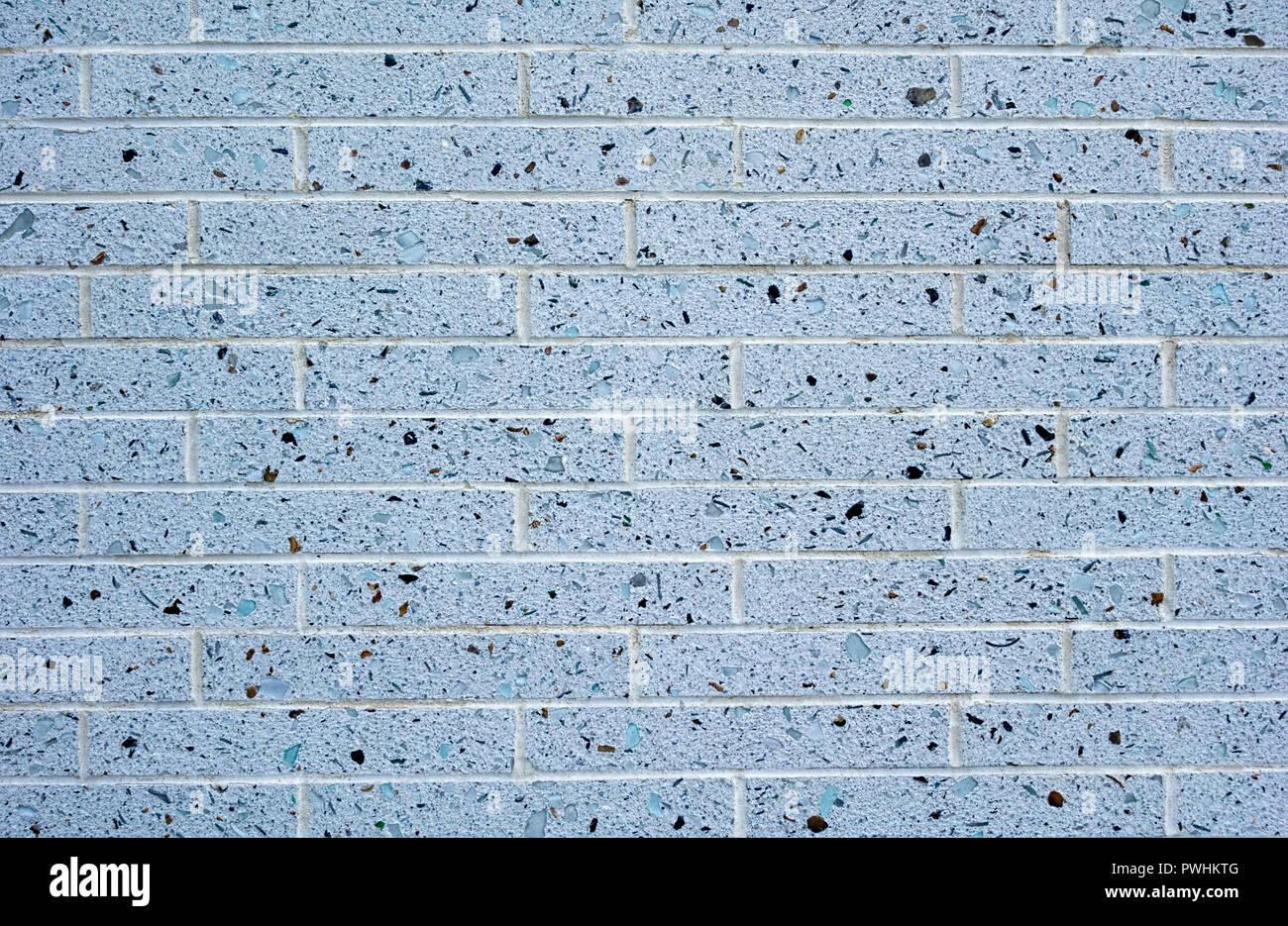 Grey flecked brick wall - Stock Image