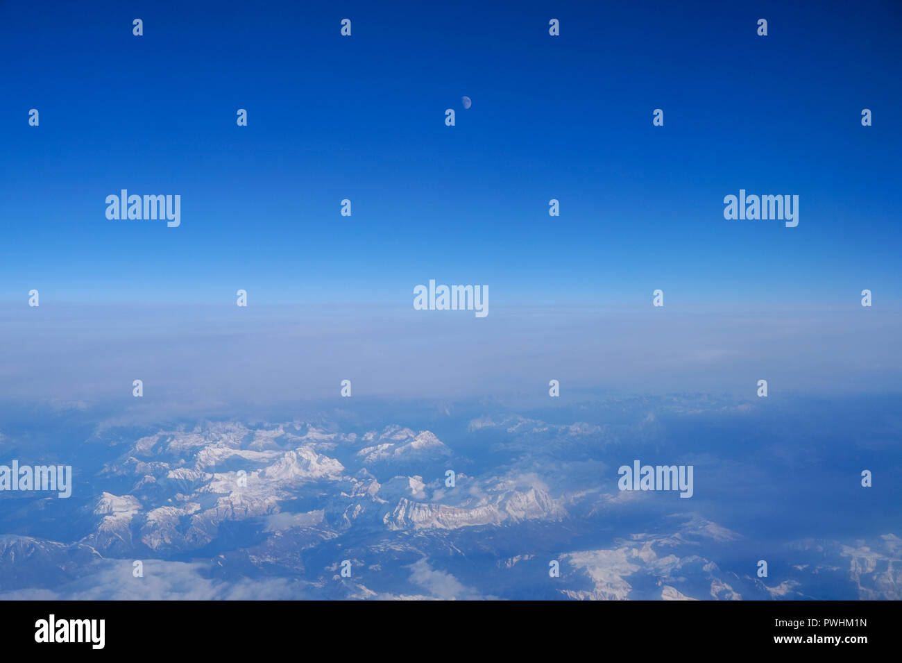Sky over the Swiss Alps with moon over top - Stock Image