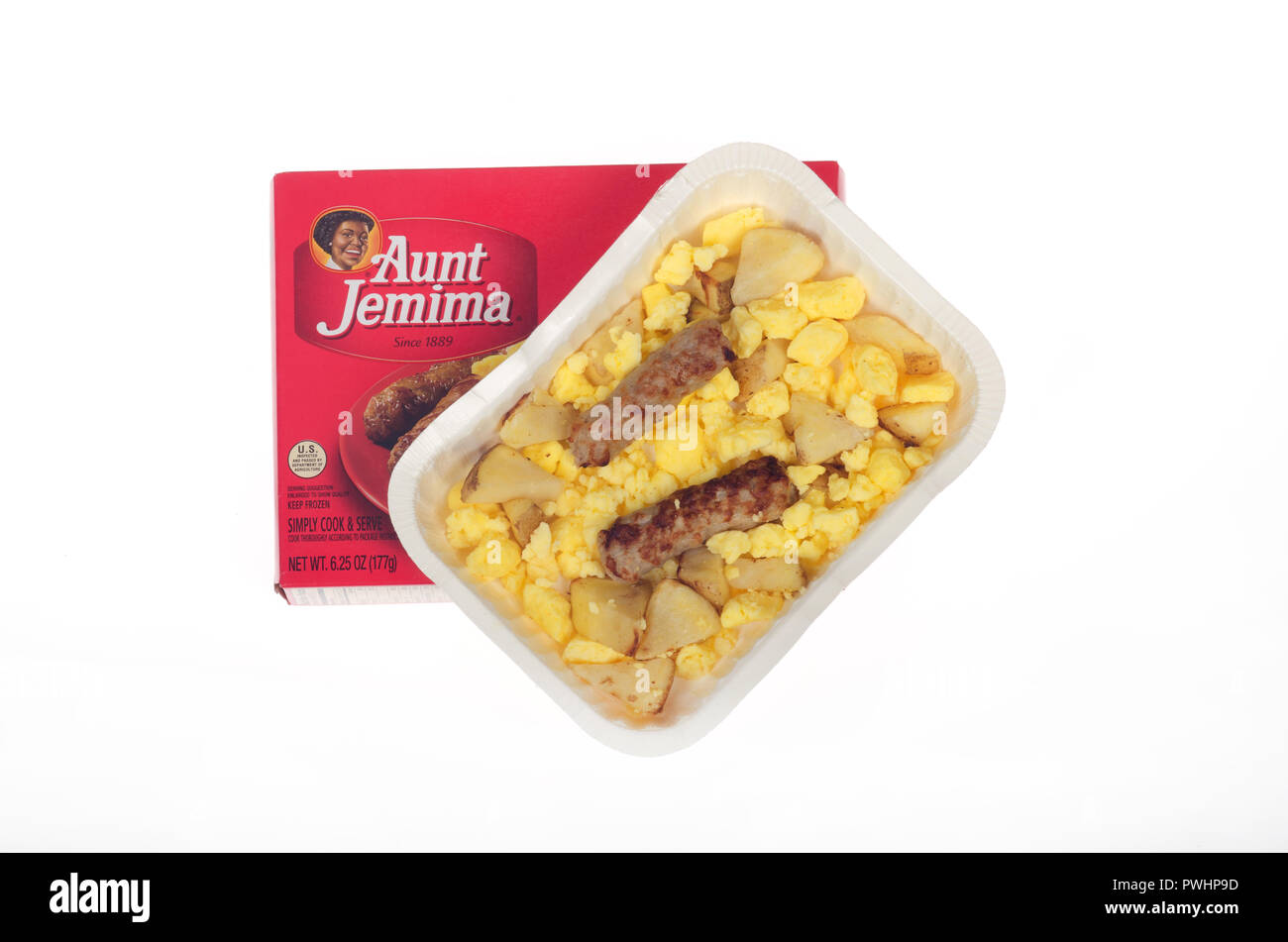 Hot, microwaved from frozen breakfast tray from Aunt Jemima of scrambled eggs, roasted potatoes and sausage links on white with box - Stock Image