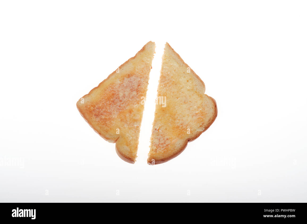 Hot buttered white toast cut in half Stock Photo