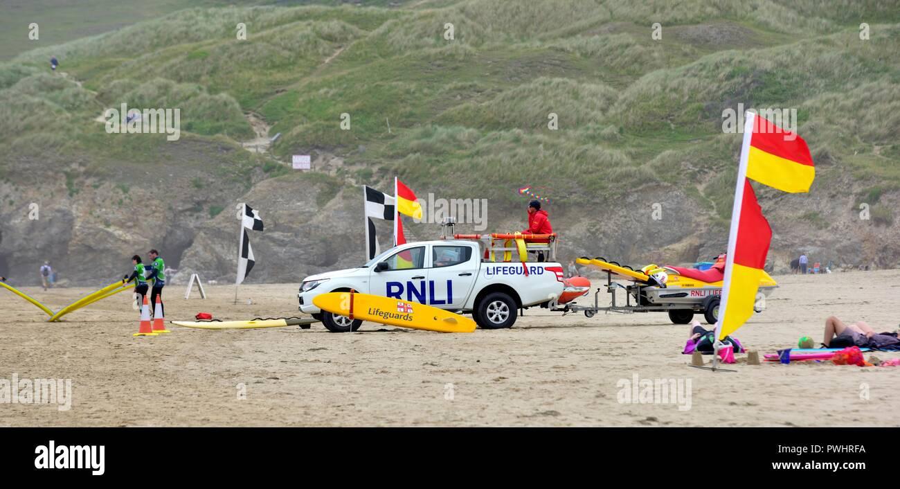 RNLI Lifeguards on duty,Perranporth beach,Cornwall,England,UK - Stock Image