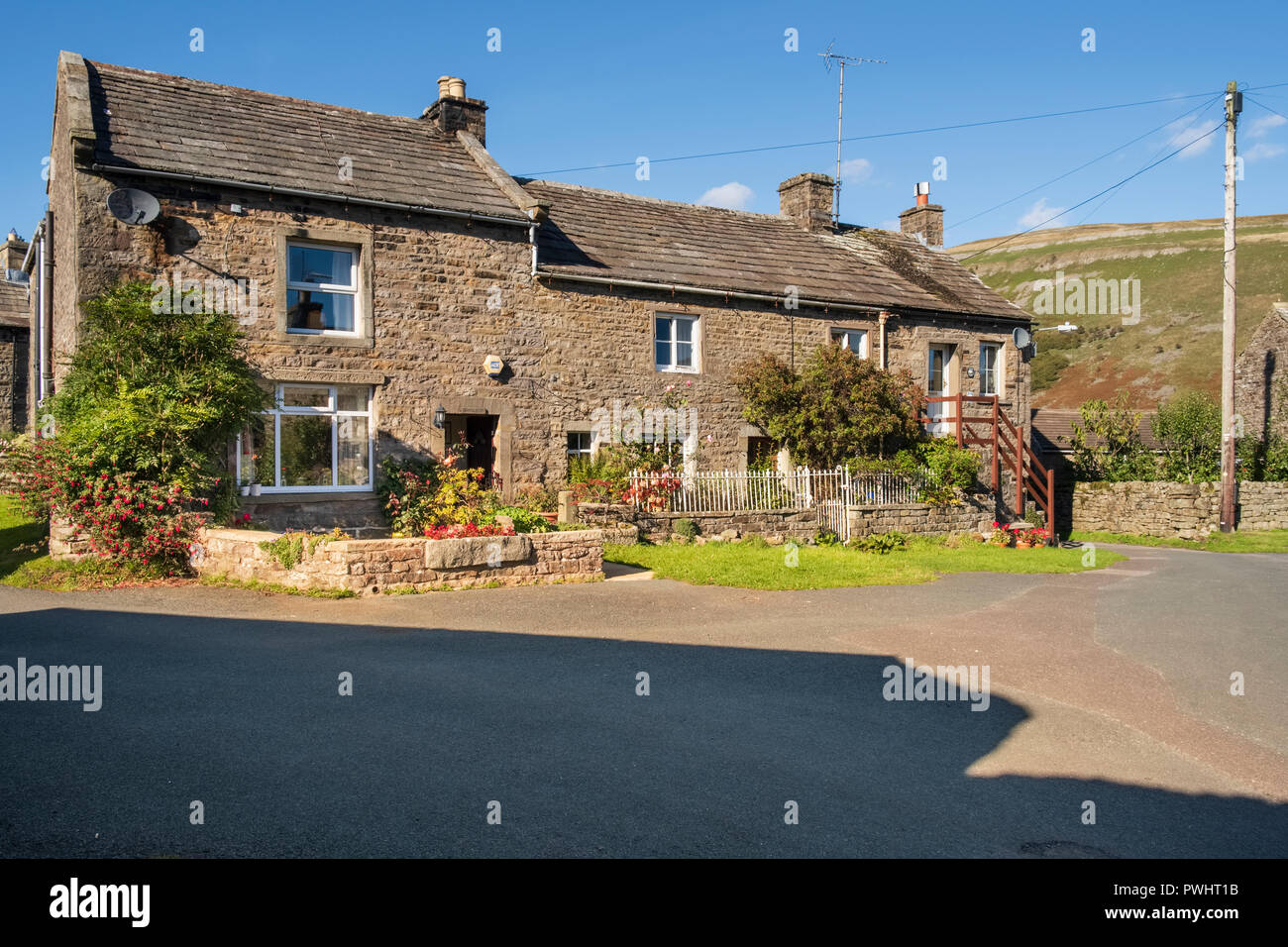 Stone cottages in Muker village in the Yorkshire Dales, North Yorkshire - Stock Image