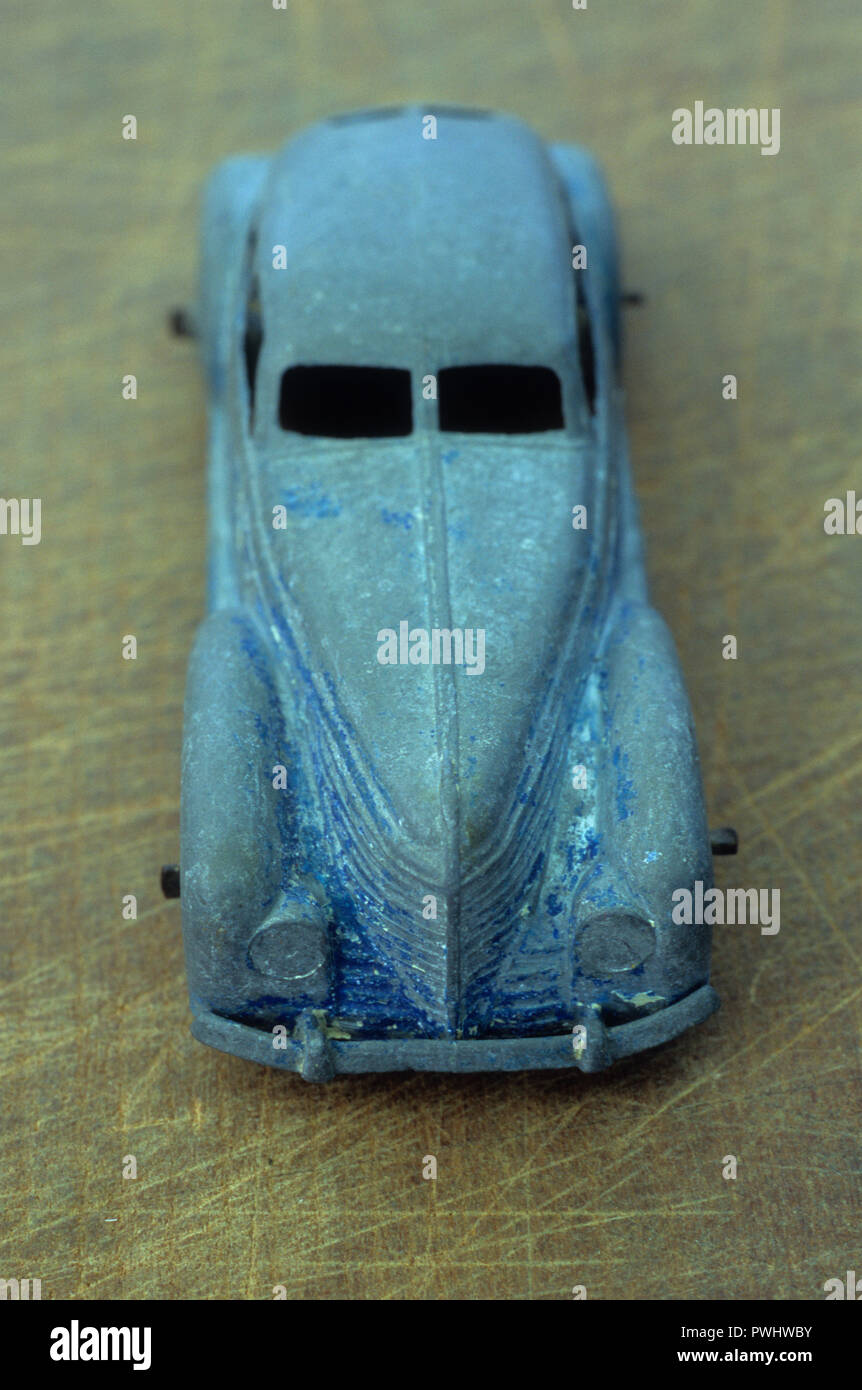 1930s lead model car once blue but now scuffed back to bare metal - Stock Image