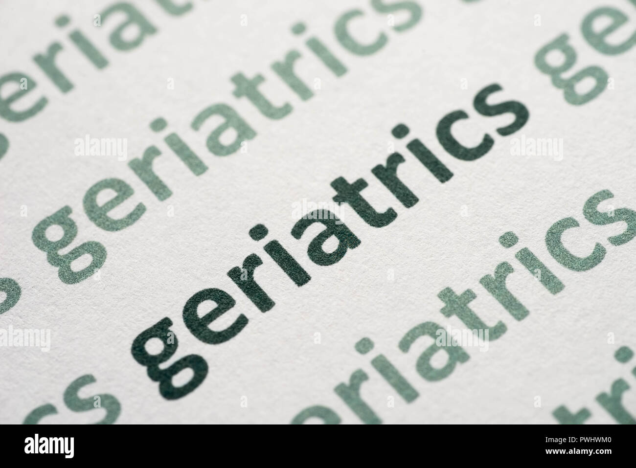 word geriatrics printed on whte paper macro - Stock Image