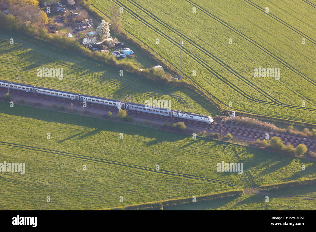 A train on the East Coast Main Line travelling to York - Stock Image