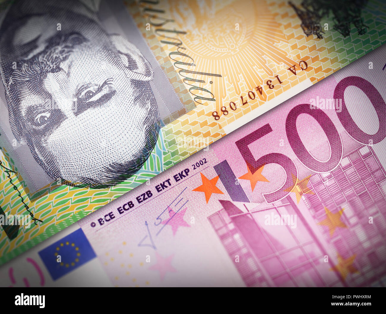 Two money bills aligned and setup next to each other symbolizing exchange business concepts. Stock Photo